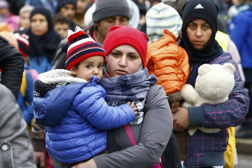 Migrants walk towards a makeshift camp in the village of Sentilj, Slovenia.