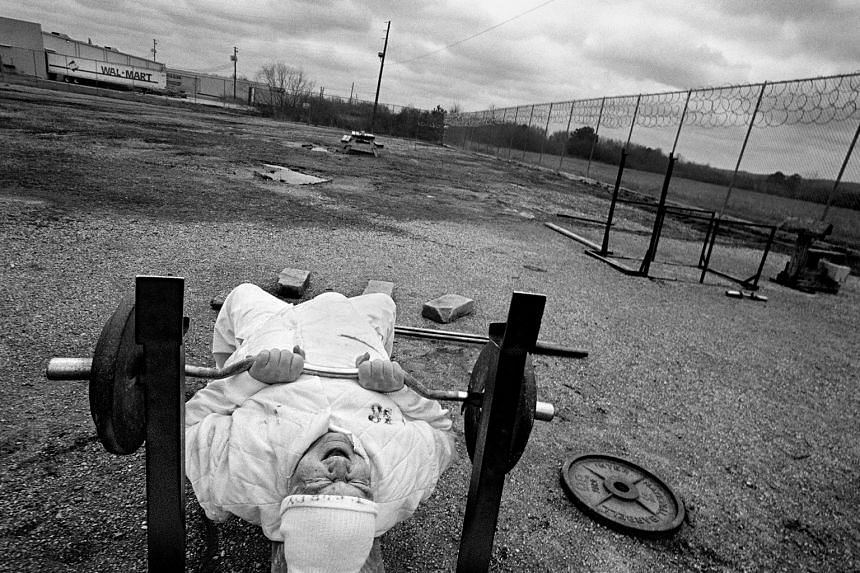 American prison inmate Truman Purdy (above), 61, lifts weights in the Hamilton, Alabama exercise yard. Over time, older inmates become more of a medical burden than a security risk, costing the state three times as much as younger inmates.