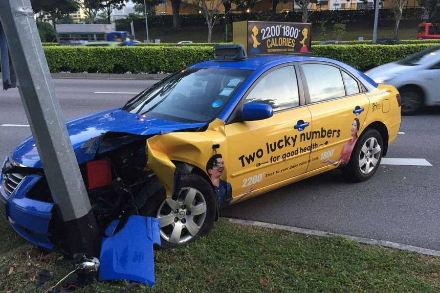 The front left portion of the blue Comfort taxi was badly mangled from the crash.