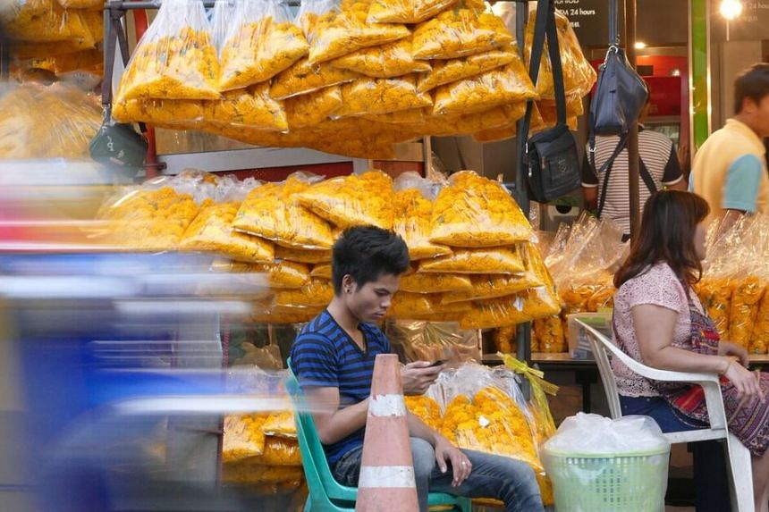 Vendors are seen hawking their wares at Pak Klong Talad, Bangkok's Flower Market. Bangkok has long been known for its dense sidewalk markets, but vendors at Pak Klong Talad are now under pressure to move to actual shops after a recent cleanup drive b