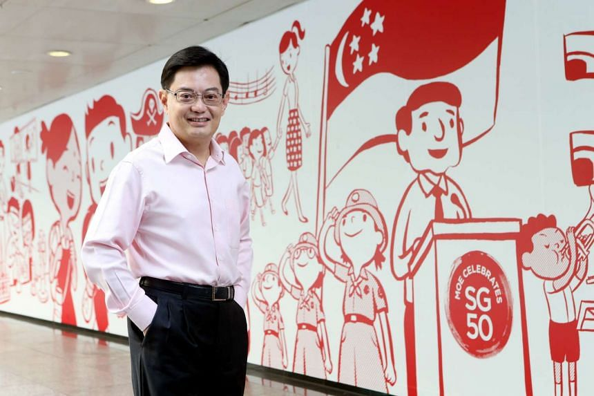 """Finance Minister Heng Swee Keat said the Budget will  focus on helping companies with their """"restructuring journey""""."""