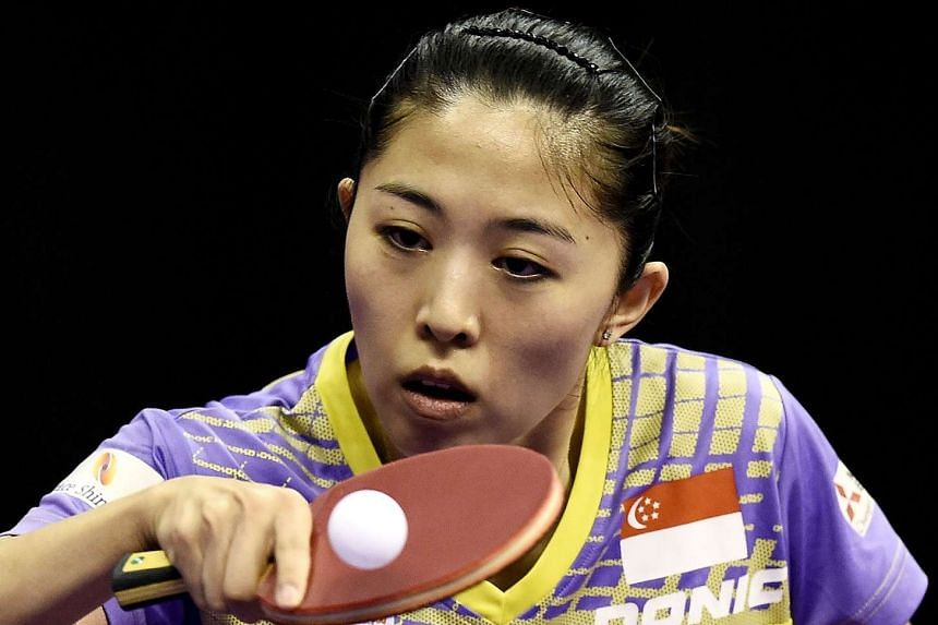 Yu Mengyu of Singapore hits a return against Ri Myong Sun of North Korea during their match on March 4, 2016.