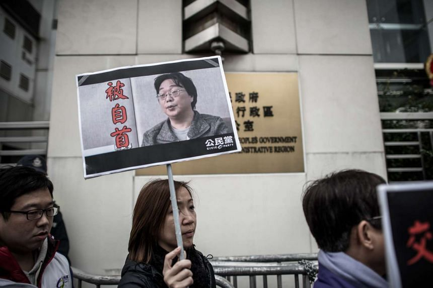 Members of the Civic party voice their concern about missing booksellers outside the China liaison office in Hong Kong on Jan 19, 2016.