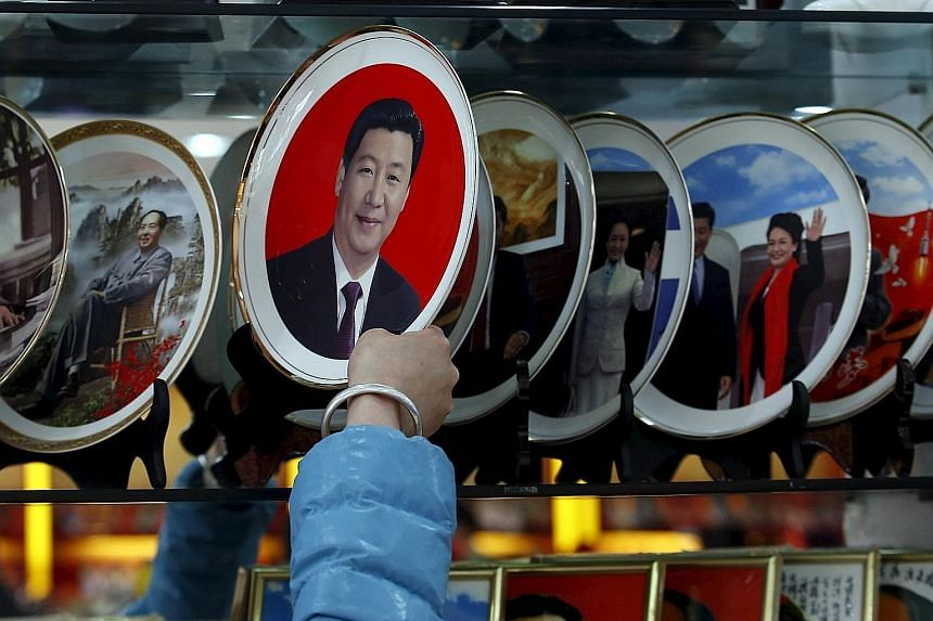 Souvenir plates bearing the images of President Xi on sale at a shop near the Great Hall of the People.