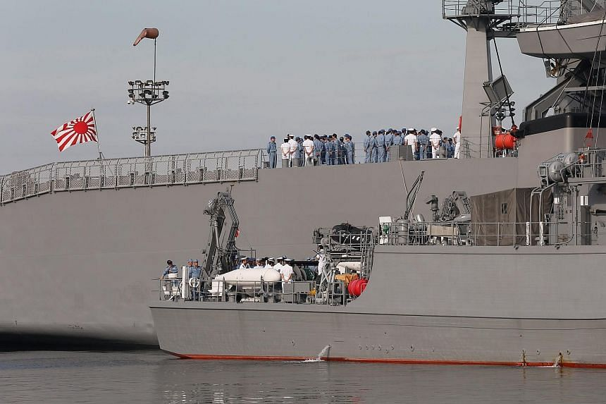 Two Japanese minesweeper- class vessels at a port in Manila yesterday, after arriving for a three-day goodwill visit on Wednesday. US Admiral Harry Harris said the annual Malabar exercise involving the navies of India, the US and Japan would be held