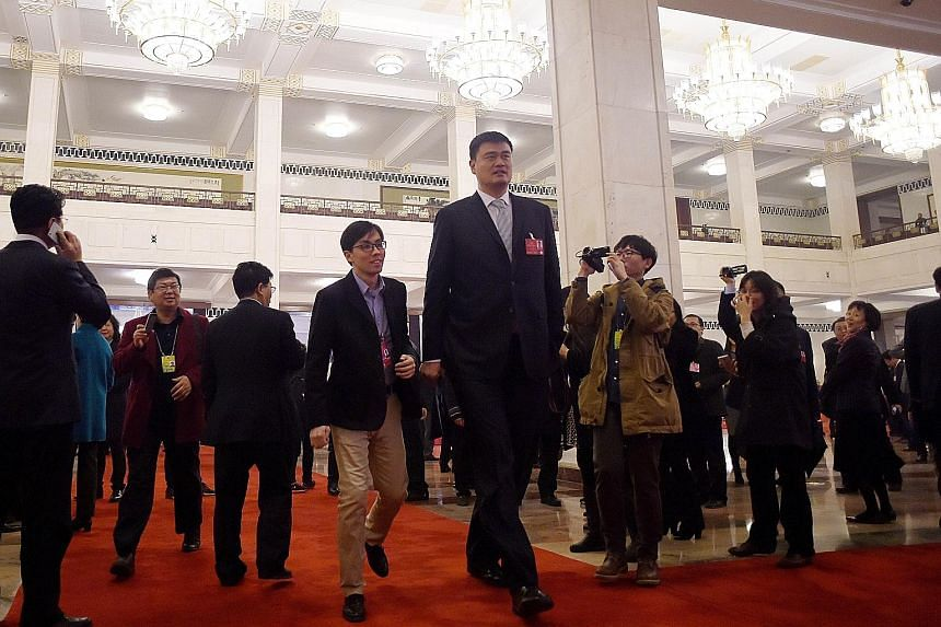 Former National Basketball Association star Yao Ming (centre) was spotted at the opening session of the Chinese People's Political Consultative Conference at the Great Hall of the People yesterday.
