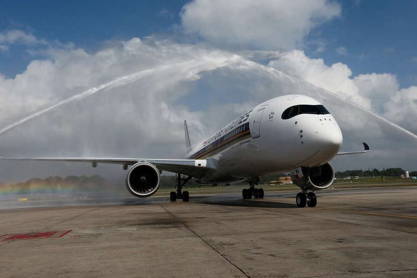 Singapore Airlines' new Airbus A350 is welcomed with a water salute at Changi Airport on March 3.