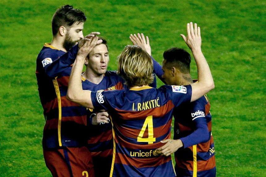 Barcelona's Ivan Rakitic (left) celebrates with Neymar (right), Lionel Messi (facing) and Gerard Pique after scoring the opening goal.