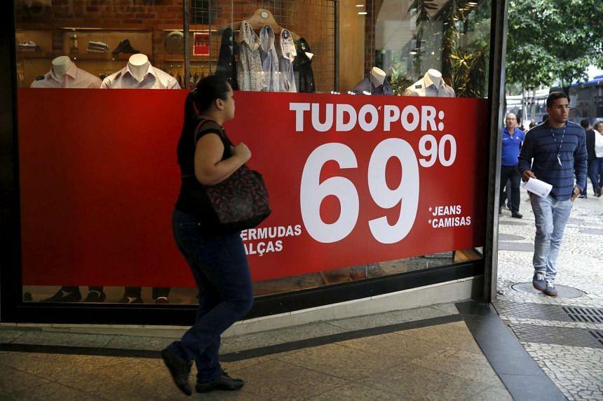 A woman walks past a boutique in Rio de Janeiro.