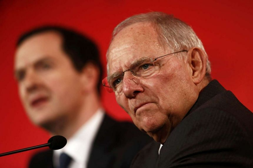 German Finance Minister Wolfgang Schauble (right) and British counterpart George Osborne in London.