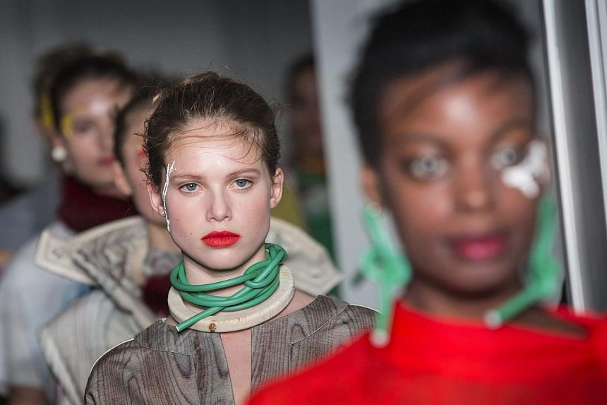 Models present creations from the Fall/Winter 2016/17 Collection by designer Liselore Frowijn during the Paris Fashion Week, on March 1, 2016.