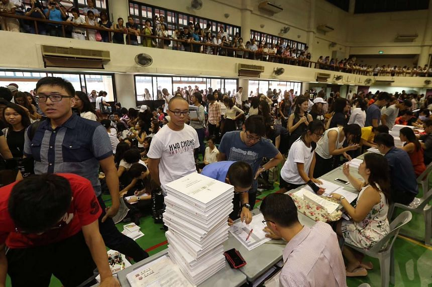 Hwa Chong Institution students collecting their GCE A-Level results in the school hall on Mar 4, 2016.