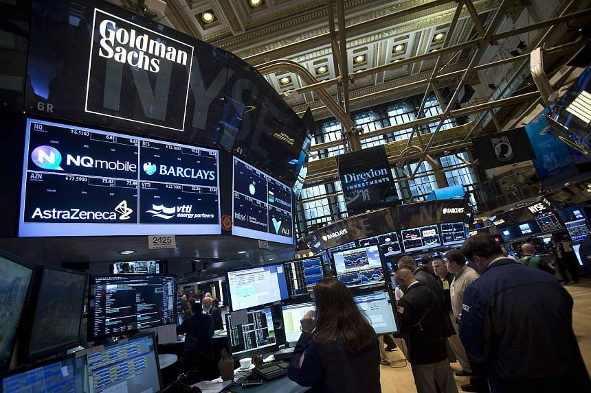 The Goldman Sachs logo is pictured on their post as traders work on the floor of the New York Stock Exchange, on Aug 4, 2014.