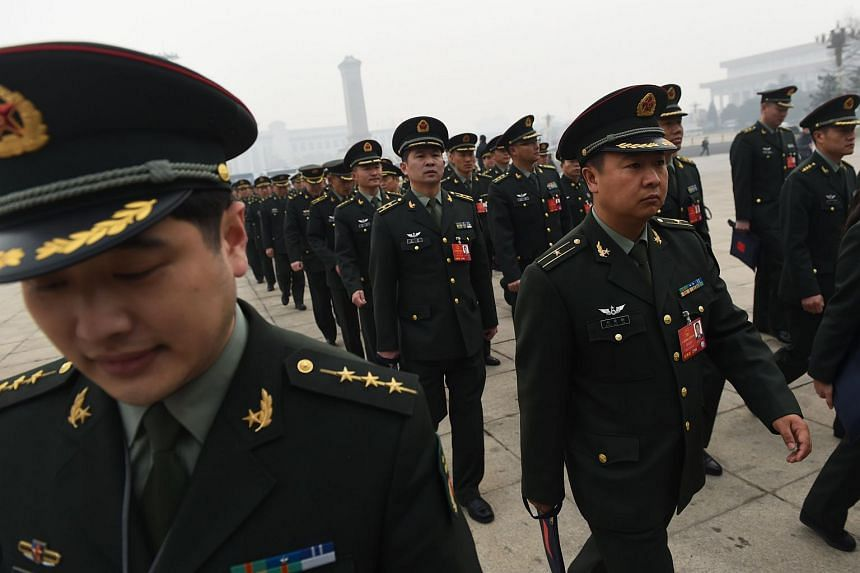 Military delegates arrive for a session of the Chinese People's Political Consultative Conference (CPPCC) in Beijing, on March 4, 2016.