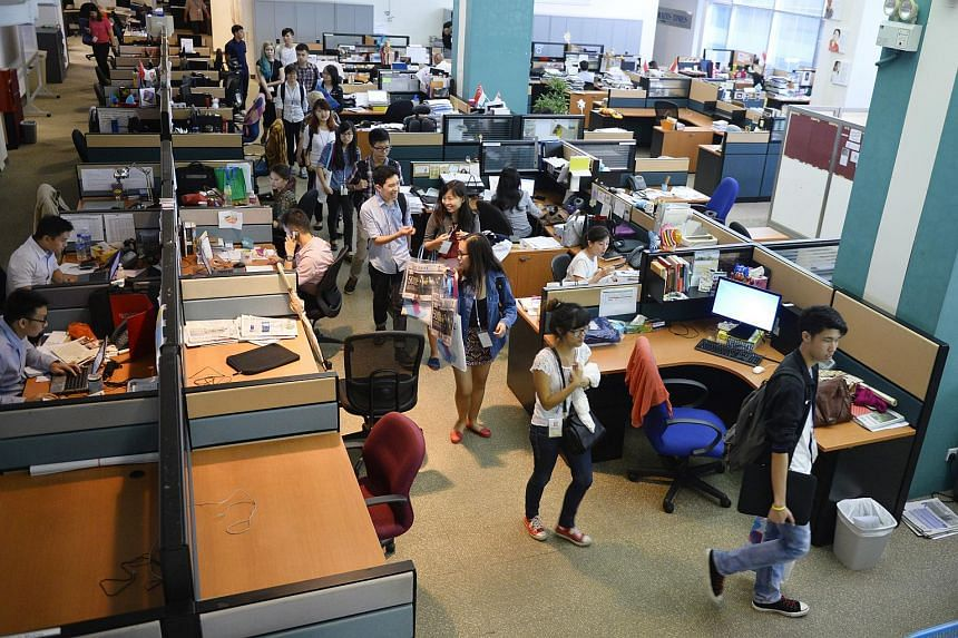 Participants taking a tour of The Straits Times newsroom during the MCCY-ST Idea Jam, on Oct 1, 2014.