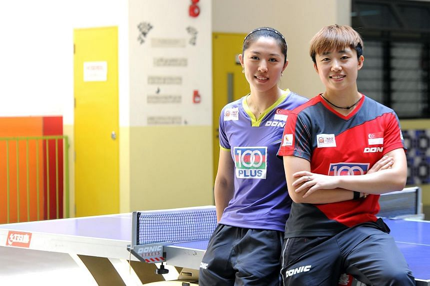 Singapore National Paddlers Feng Tianwei (right) and Yu Mengyu.