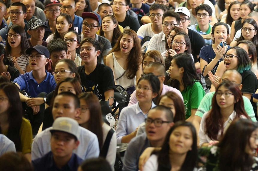 Hwa Chong Institution students reacting during the principal's address.