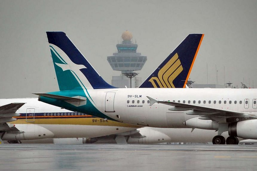 A SilkAir (right) and a Singapore Airlines (SIA) plane at the Changi Airport.