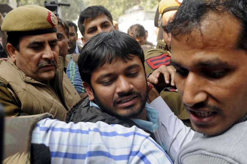 Kanhaiya Kumar (centre) being escorted by police outside court on Feb 17, 2016.