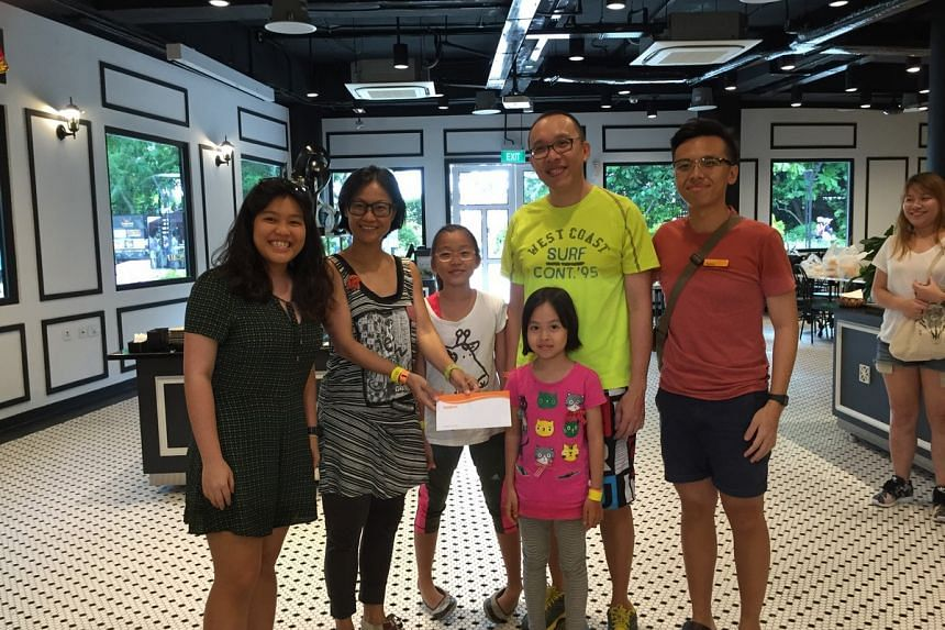 The Yim family, comprising dad Yim Kein Kwok (second from right), mum Janice Phang (second from left), and siblings Lisa Yim and Maya Yim, emerged the overall winners of the inaugural Sentosa Family Fun Challenge.