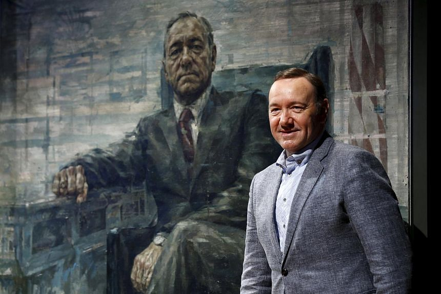 Actor Kevin Spacey standing beside a portrait of his House of Cards character Frank J. Underwood at the Smithsonian's National Portrait Gallery in Washington on Feb 22.