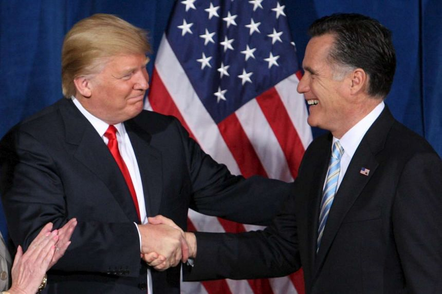 Trump (left) greets Romney in 2012 after endorsing his candidacy for president.