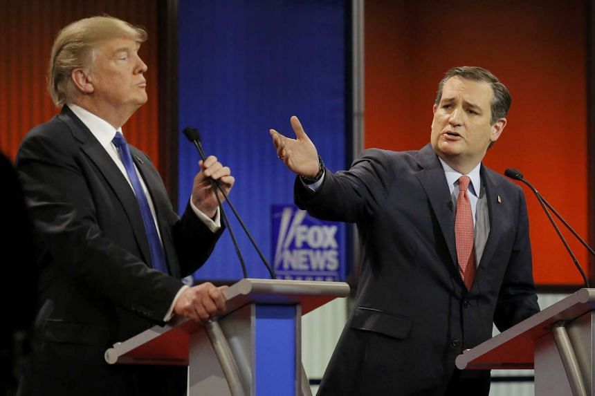 Republican presidential candidate Ted Cruz (right) gestures at rival Donald Trump at a debate in Detroit on March 3.
