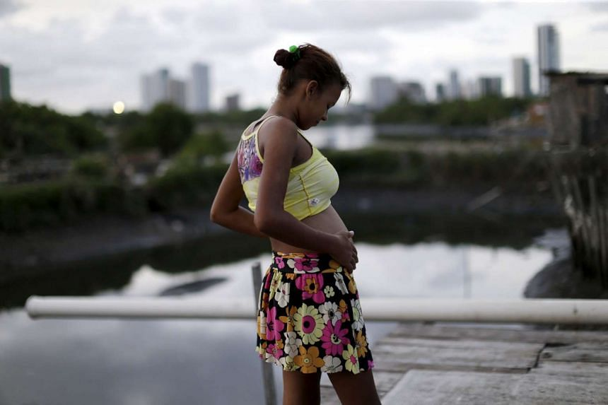 Eritania Maria, who is six months pregnant, is seen in front of her house at a slum in Recife, Brazil, on Feb 2, 2016.
