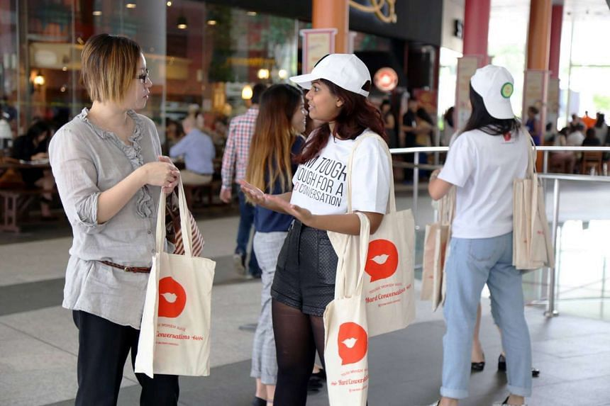 Students from Nanyang Technological University giving out a souvenir bag to participants during the Hard Conversations campaign which focused on raising awareness of erectile dysfunction (ED) amongst women.
