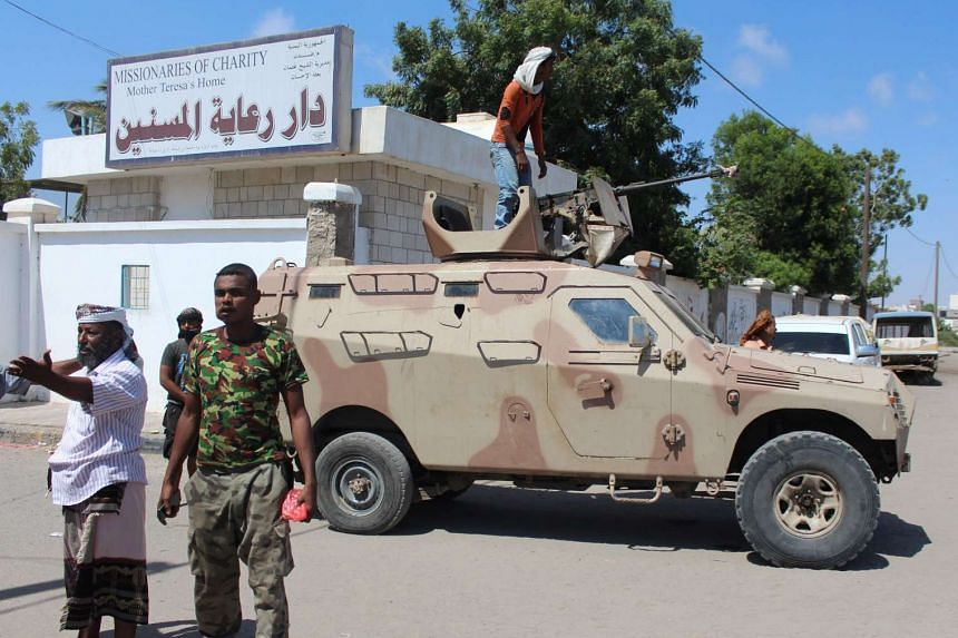 Yemeni security forces gather outside an elderly care home in Yemen's main southern city of Aden after it was attacked by gunmen on March 4, 2016.