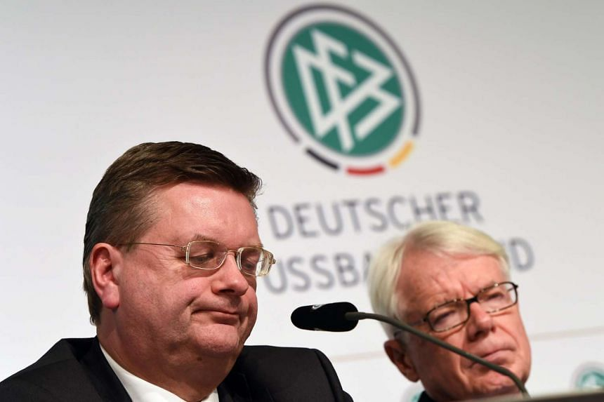 Reinhard Grindel (left), treasurer of the German Football Association (DFB), and Reinhard Rauball (right), first vice president of the DFB, attend the presentation of the investigation report on the affair surrounding the Fifa World Cup 2006 in Frank