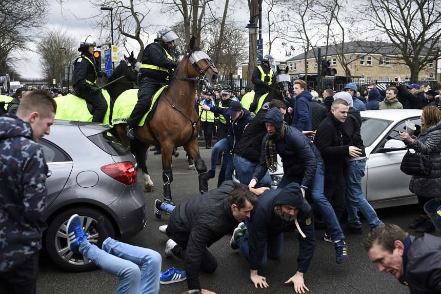 Policemen and fans clashing outside White Hart Lane before the match.