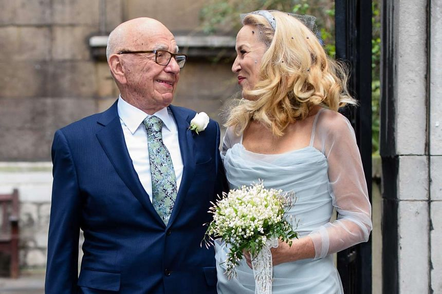 Media magnate Rupert Murdoch (left) and his new bride, former US model Jerry Hall outside St Bride's church on Fleet Street in London on March 5, 2016.