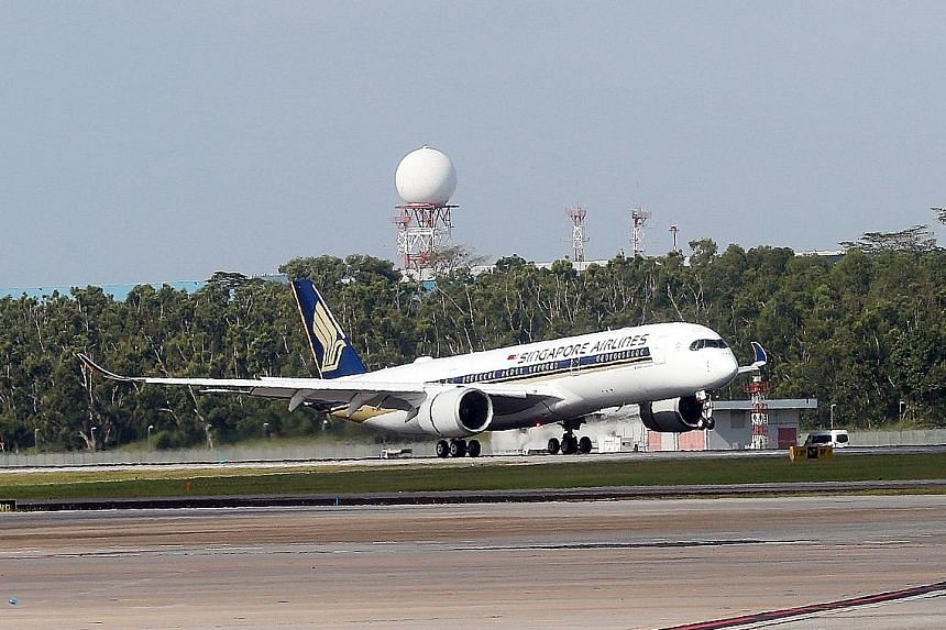 Singapore Airlines' first A-350 arriving at Changi Airport on Thursday. Airbus' project to launch its new jetliner is the latest move in a game of leapfrog played by the European planemaker and Boeing over the past decade in the market for big twinje