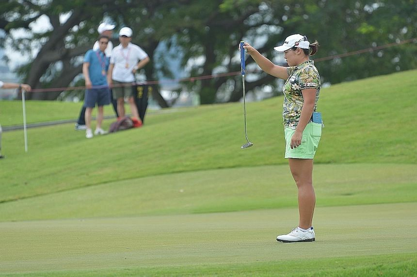 South Korean Jang Ha Na weighs up a putt during the second round of the HSBC Women's Champions yesterday. She currently holds the lead at the Sentosa Golf Club with her compatriot Lee Mi Rim.
