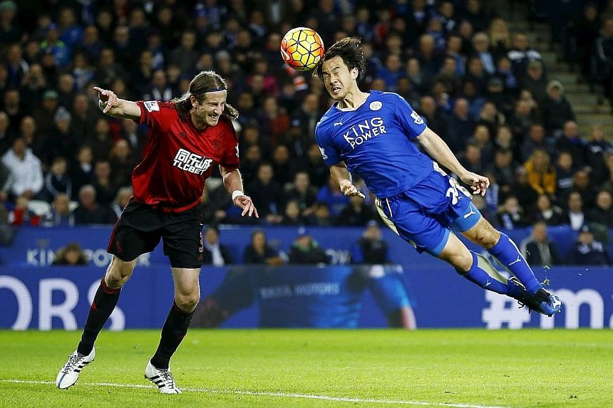 Leicester City's Shinji Okazaki beats West Bromwich Albion's Jonas Olsson to the ball in Tuesday's 2-2 draw at the King Power Stadium. The Japanese striker will hope to get the nod to lead the line for his table-topping side when they visit Watford,