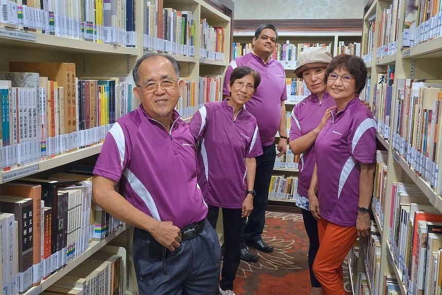 Volunteers at the library include (from left) Mr David Lim, Ms Chow Wai Ling, Mr Dhara Venkata Agoya Kumar, Madam Yang Jun and Madam June Tan. The library is on the fourth floor of Chinatown Point.