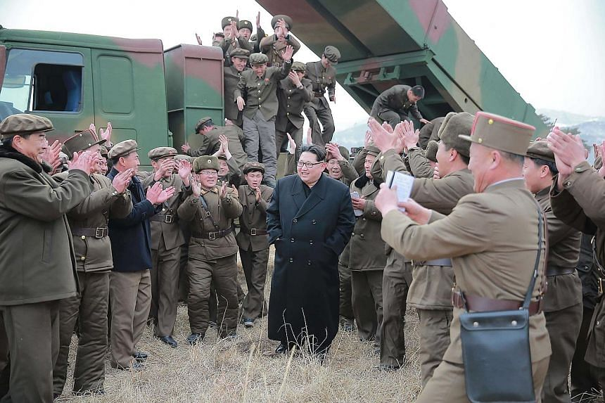 North Korea's multiple launch rocket system being test fired. Analysts say a nuclear test in January and last month's launch of a long-range rocket indicate that the North has made technical advances in its nuclear weapons programme. North Korean lea