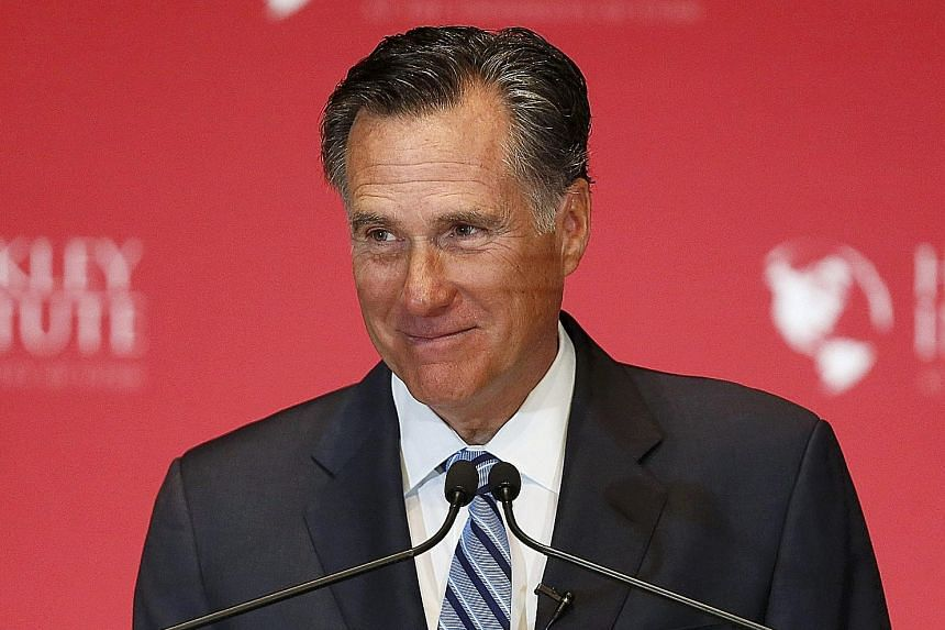 """Former Republican presidential nominee Mitt Romney (above) called his party's front runner Donald Trump a """"fraud"""" who would drive the US to the point of collapse."""