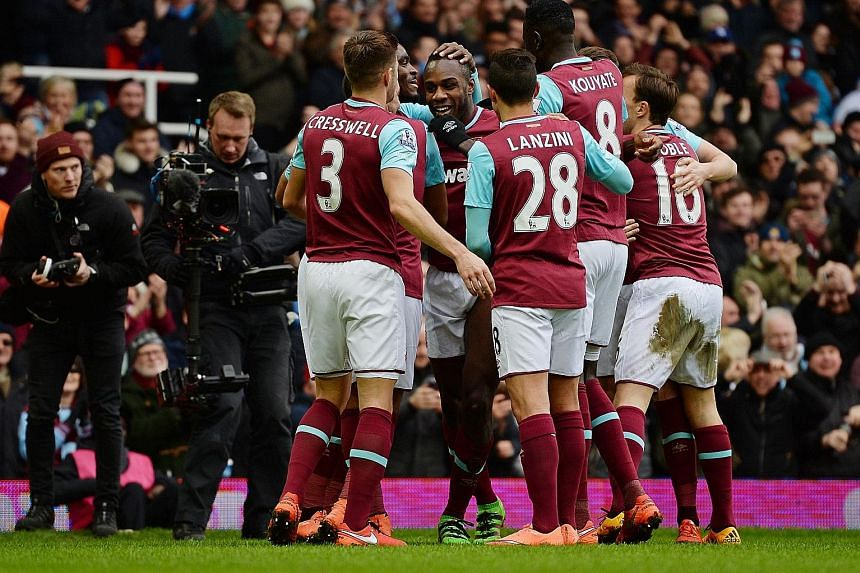 West Ham's Michail Antonio celebrating his goal in the 1-0 league win against Sunderland last Saturday. Slaven Bilic has given the team added steel while Dimitri Payet has proved his worth with key goals.