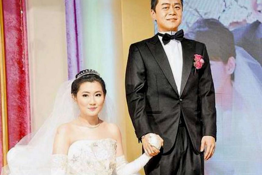 Selina Jen, (left) singer of popular Taiwanese girl group S.H.E, with her husband, lawyer Richard Chang, during their wedding day on OCt 31, 2011.
