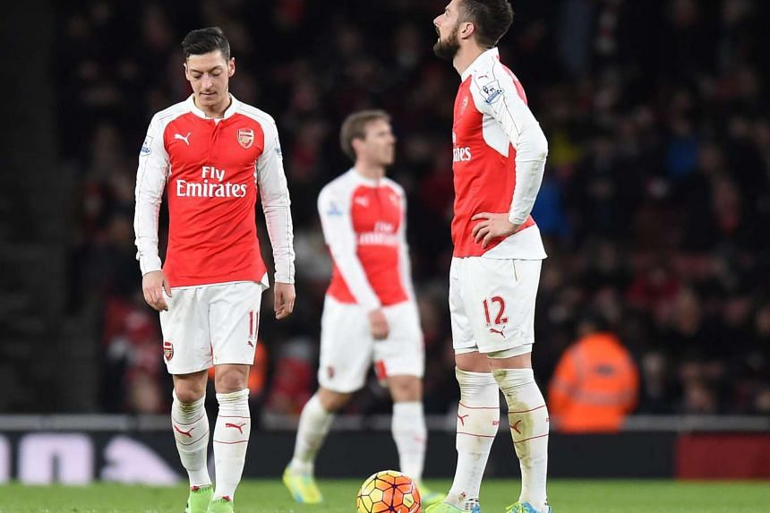 Arsenal's Mesut Oezil (left) and Olivier Giroud (right) reacting during the English Premier League game between Arsenal and Swansea City on March 2, 2016.