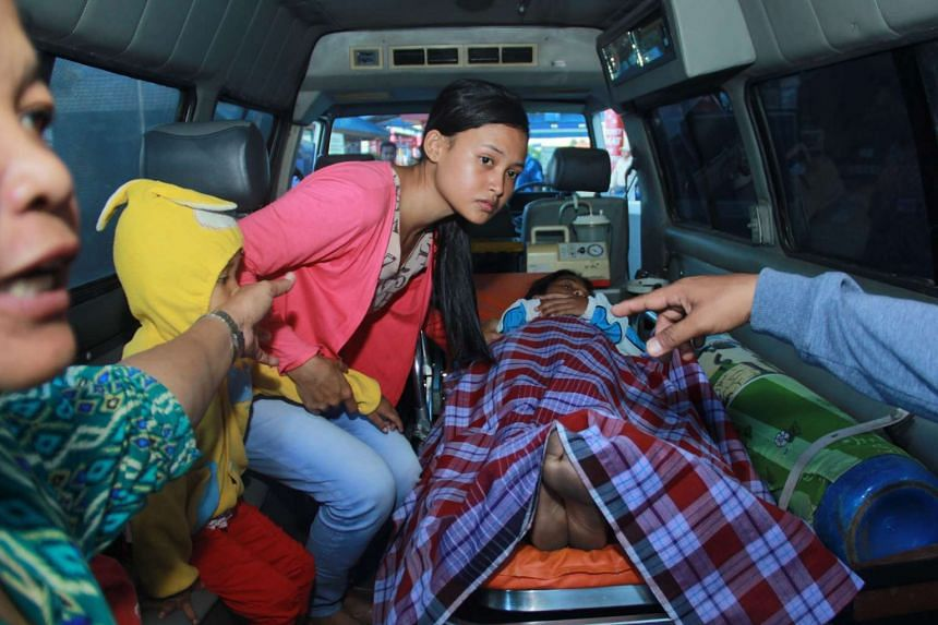An ambulance carrying passengers rescued from the capsized ferry, in Banyuwangi, Indonesia, on March 4.