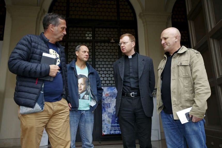 Father Hans Zollner (second, right) talking with Mr Andrew Collins (right), Mr David Ridsdale (left) and Mr Peter Blenkiron, who said they were child sex abuse victims, at the end of a meeting in Rome, Italy, on March 3, 2016.