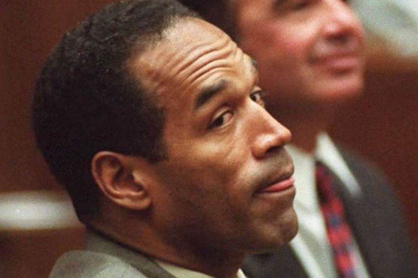 A 1995 file photo shows murder defendant OJ Simpson listening to the prosecution in Los Angeles.