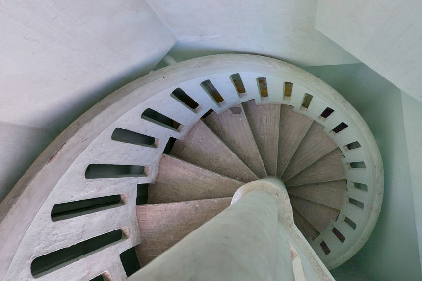 The building's spiral staircase (above) and its facade.