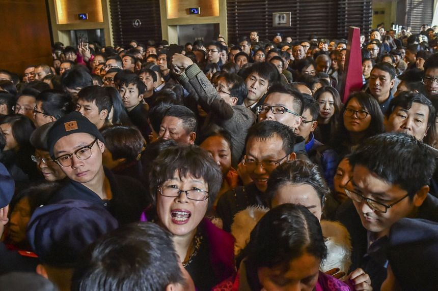 A crowd waiting as a residential compound opened for sale in Hangzhou last month. The city is planning to give migrant families local household permits, or hukou, to encourage them to buy homes in four counties.