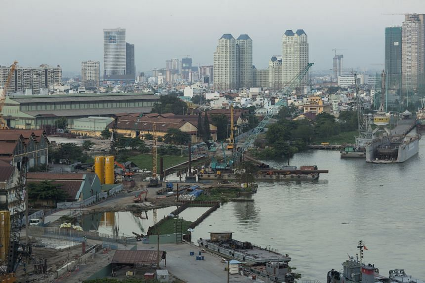 Ongoing development projects (above) in Ho Chi Minh City with its rising skyline; and the Notre-Dame Cathedral Basilica, also in the Vietnamese city.