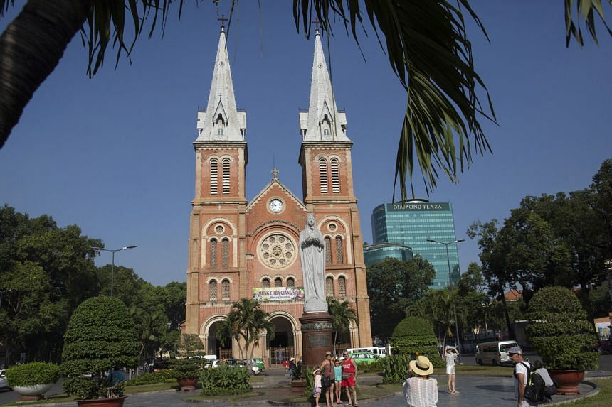 Ongoing development projects in Ho Chi Minh City with its rising skyline; and the Notre-Dame Cathedral Basilica (above), also in the Vietnamese city.