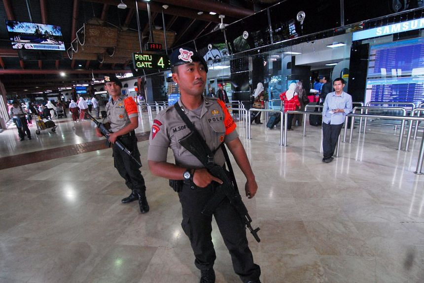 Police officers on guard inside a terminal of the Soekarno-Hatta international airport in Jakarta, which was one of the other planned terror targets, apart from police posts and stations, an international school, as well as Bali and other places frequente